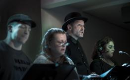 "Actors Bryan Mitchell, Jeanne Ragonese, Jörg Witzsch and Cindy Halbert-Seger in a scene from the radio play ""Sorry Wrong Number"" by playwright Lucille Fletcher. Photo: Uka Meissner-DeRuiz"