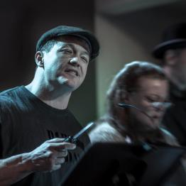 "Actors Bryan Mitchell, Jeanne Ragonese and Jörg Witzsch perform a scene from the radio play ""Sorry Wrong Number"" by playwright Lucille Fletcher. Photo: Uka Meissner-DeRuiz"